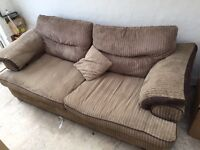 2 large sofas and a foot stool with storage