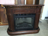 Mantle with electric fireplace insert