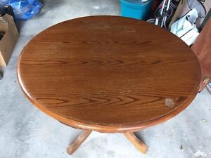 "42"" solid oak table includes leaf - no chairs -$175"