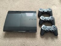 PS3 slim with 3 controllers and 14 games including GTA5 and CoD Advanced warfare