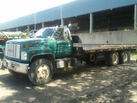 GMC w/ NRC tilt and load tow truck flatbed