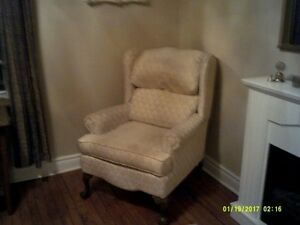cream color wing chair