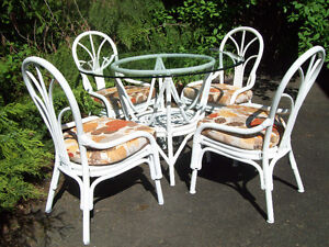 glass topped rattan table and 4 chairs