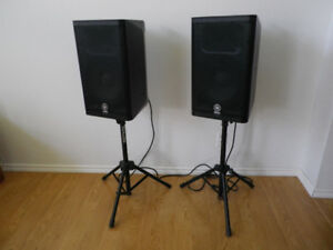 Pair of Yamaha DXR10 speakers with stands.