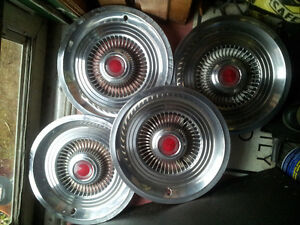 Four Vintage Stainless Steel Hubcaps