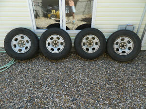"""Nissan 16"""" winter tires and rims"""