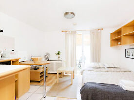 Naturally bright SELF CONTAINED STUDIO with EN SUITE shower and use of maintained shared GARDEN.