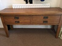 Dark oak console table with two draws.