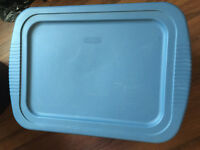 A big blue plastic storage box for sale