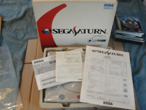 Japanese Sega Satrun with original packaging  and games
