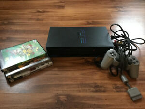 Playstation 2 with three games.
