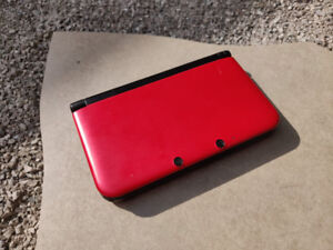 Red 3DS XL With Charger, Case and Games. Good Condition.