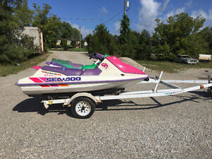 1995 & 1993 GTX Seadoo and easy loader trailer