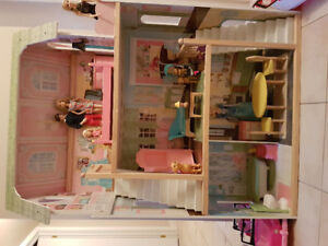 Doll house with cars.