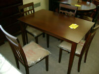 New table and four chairs. Only $299.