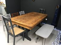 8 seater restored solid wood dining table with iron feature