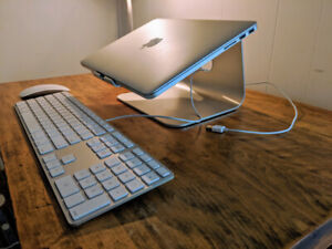 Silver Macbook stand, and Apple mouse