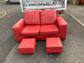 ,2 seater sofa/sofa bed in red leather with 2 footstools £150
