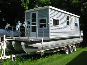 Houseboat, with trailer and 115 Johnson outboard motor