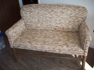 Antique love seat that was  re-upholstered