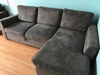 L-shaped settee with sofabed built in. One matching arm chair
