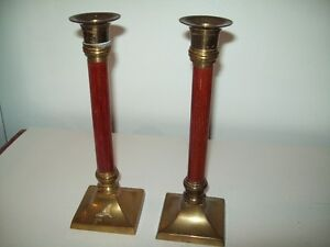 PAIR OF VINTAGE BRASS AND WOOD CANDLESTICKS