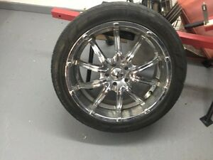 4 - 20 inch Pirelli tires with chrome mag wheels