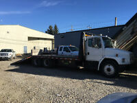 Towing, equipment hauling and scrap car removal