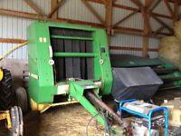 John Deere 335 hard core hay round baler, stored inside
