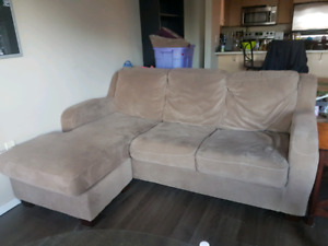 Beige couch with pullout bed for sale