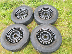 Set of 4 Winterforce 215 70 R16 tires and rims