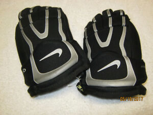 "Nike 10"" black hockey gloves."