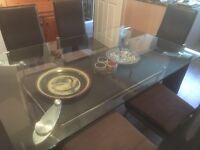 Glass dining table and 6 chairs.