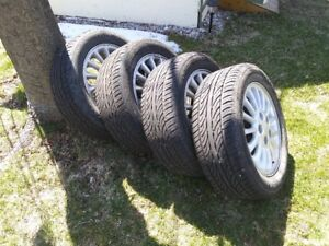 4 rims and tires 225 50 16