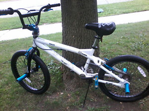 "Blue and white 20"" 3 month old BMX front and back pegs"