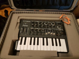 Arturia microbrute synthesizer with hard case