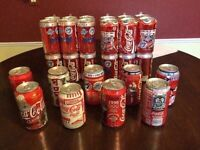 Lot of coca cola collectible cans