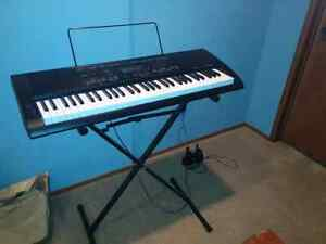 Piano keyboard with c/w stand