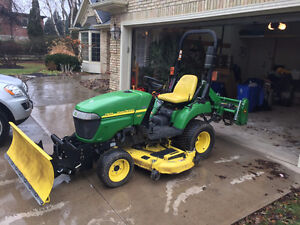 John Deere 2305 Tractor with mower, hydraulic plow and tiller.