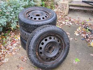 Set of 4 Aurora winter tires  175/65 R14 used on a 1999 corolla