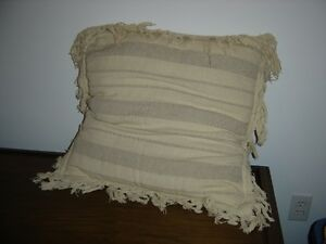 Large beige accent cushion