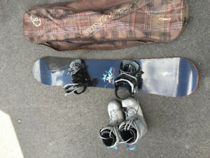 Snowboard with boots and carrying bag