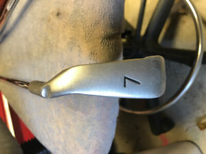 Assorted name brand golf clubs