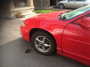 2002 Pontiac Grand Prix red Sedan