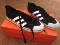 Two pairs UK 6 trainers