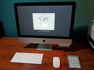 """iMac 21.5"""" bundle in new condition"""