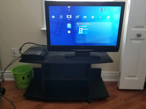 32 inch Sharp TV and TV stand for sale