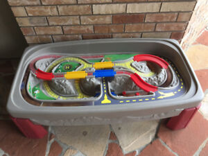 Train/car track play table. Covered with hard top