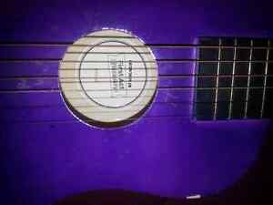 Kid guitar with 5 replacement strings