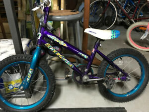 Two kids Bikes.  A 15 inch blue Super Cyle- 14 inch Barbie